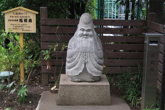 東京都錦秋稲荷大明神の像